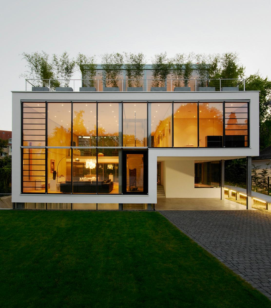 dazzling-small-sustainable-homes-design-inspiration-showcasing-glass-wall-house-architecture-with-roof-terrace-feat-green-ornamental-plans-and-green-grass-front-garden-ins